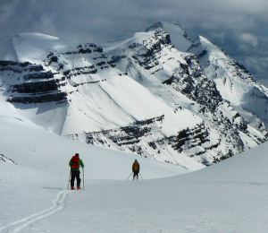 Skiers in the mountains with backpacks